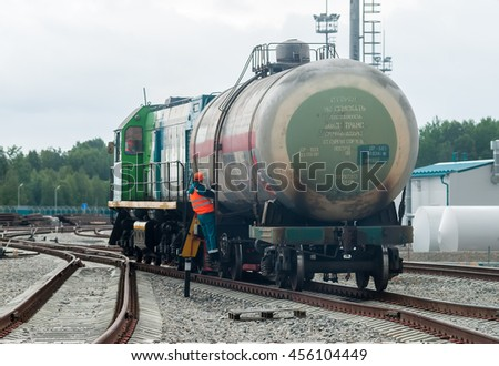 Tobolsk, Russia - July 15. 2016: Sibur company. Denisovka railway station. Shunting locomotive transports the tank on other way