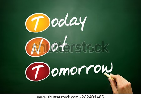 Today Not Tomorrow (TNT), business concept on blackboard - stock photo