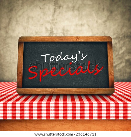 Today's Special Title in white chalk on Restaurant Blackboard. Food and Nutrition background. - stock photo