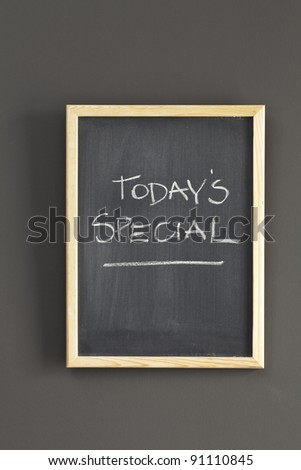 Today's Specials sketched on chalkboard - stock photo