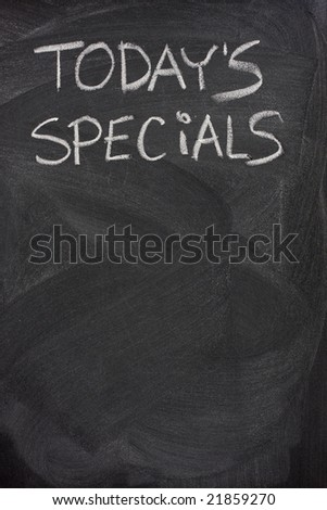 today's specials title handwritten with white chalk on blackboard, copy space below - stock photo