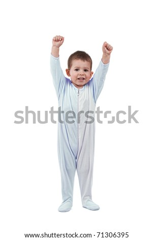 Toddle in pajamas whit hands up,  isolated on white - stock photo