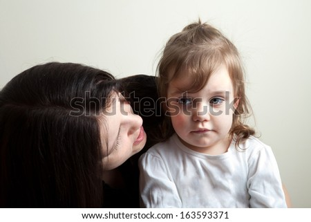 Toddler age girl getting spoken to by her mother. Great parenting concept image. - stock photo