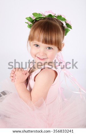 Toddler ballet girl in pink against white background - stock photo