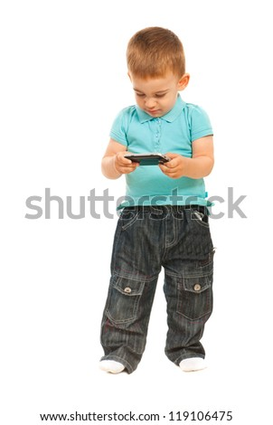Toddler boy holding phone mobileand sending sms message isolated on white background - stock photo