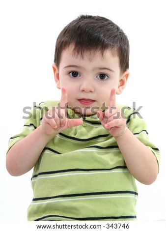 "Toddler boy holding up fingers ""how big"" over white background."