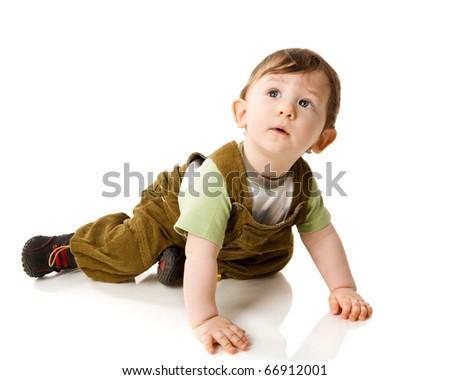 Toddler boy lying on floor isolated on white - stock photo