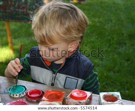 Toddler boy painting - stock photo