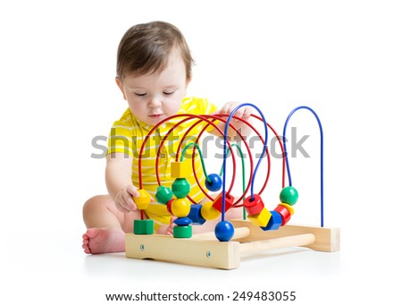 toddler boy playing with colorful toy isolated - stock photo