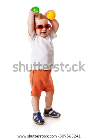 toddler boy playing with toys  isolated on white