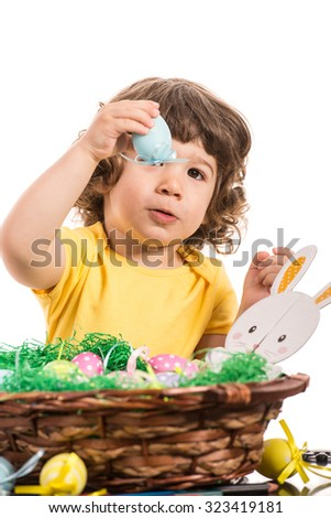 Toddler boy showing Easter egg isolated on white background - stock photo