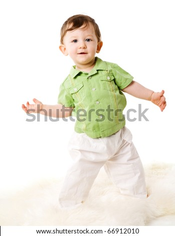 Toddler boy standing on floor isolated on white