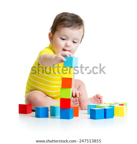 toddler child boy playing  wooden toy blocks isolated - stock photo