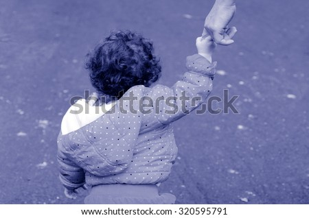 Toddler child girl age one two (1-2) years hold hands and walks on a path in the park with her mother.Children concept Horizontal Copy Space - stock photo