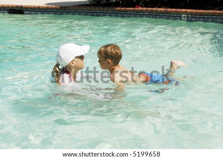 Toddler child taking swimming lessons - stock photo