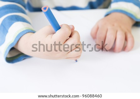 Toddler demonstrates a poor pencil grip - stock photo