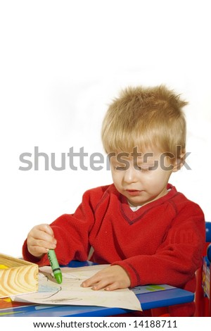 Toddler drawing with crayons. - stock photo