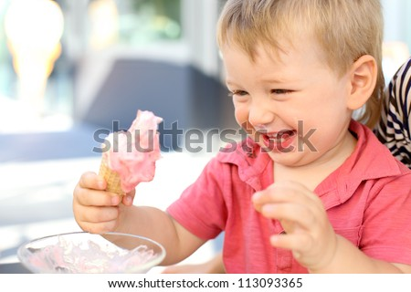 Toddler eating ice-cream - stock photo