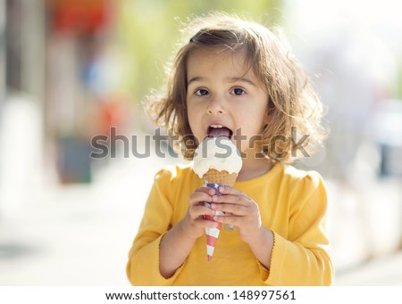 Toddler Eating Ice Cream - stock photo