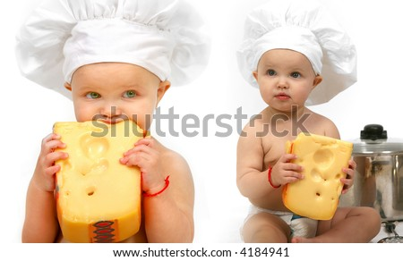 toddler girl eating a piece of large cheese - stock photo
