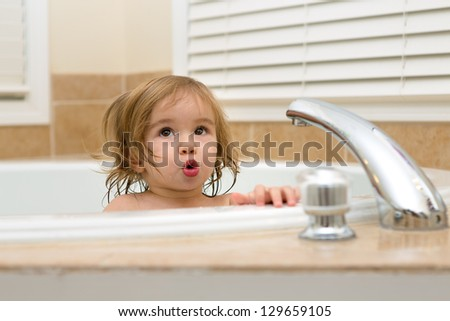 Toddler girl giving expression that needs hot water to take her bath