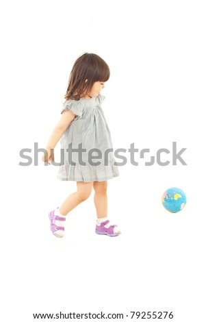 Toddler girl in action playing soccer with world globe isolated on white background - stock photo
