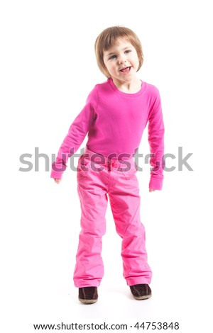 Toddler girl in pink outfit laughing