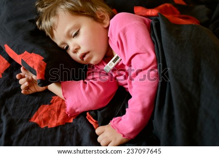 toddler girl  is ill and she is laying in the bed - stock photo