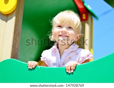 toddler girl on the playground - stock photo