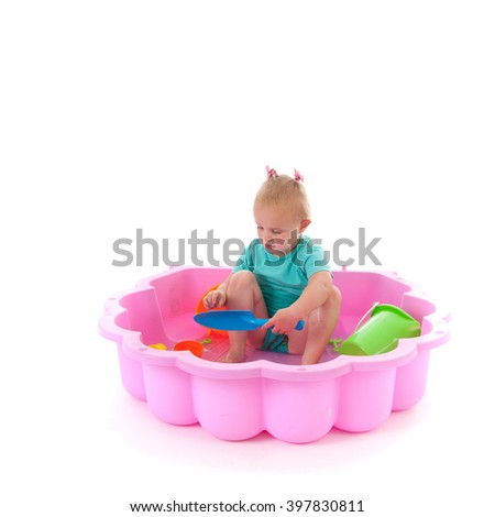 Toddler girl playing in swimming pool isolated over white background - stock photo