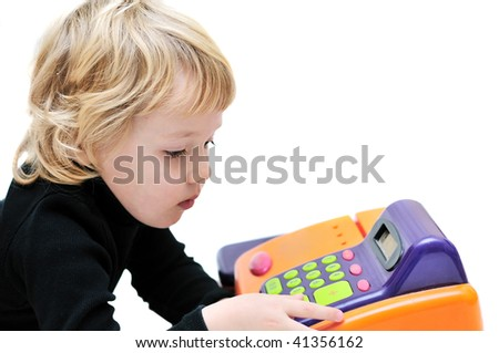 toddler girl playing with cash register over white. - stock photo