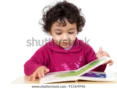 Toddler Girl Reading a Picture Book, Isolated, White - stock photo