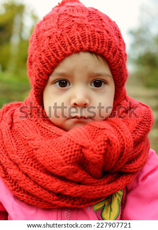 toddler girl wearing red scarf and hat in fall - stock photo