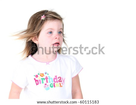 Toddler girl with wind blown hair isolated on white background