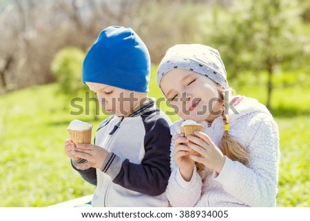 Toddler happy children eating ice cream in spring - stock photo