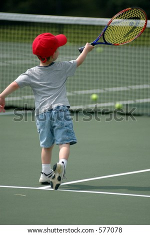 Toddler Hitting Forehand Tennis Shot