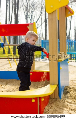 Toddler is playing at the playground