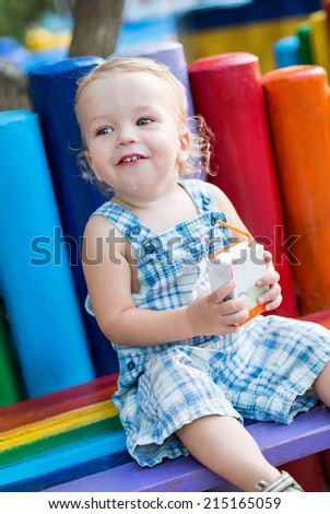 toddler lovely  drinking juice from straw - stock photo