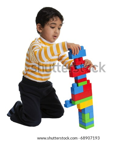 Toddler Making a tall Building with Blocks - stock photo