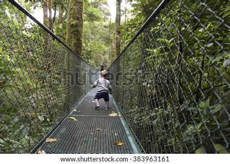 Toddler on hanging bridges in rainforest, Costa Rica