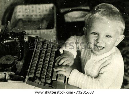 toddler played with a typewriter, Kursk, USSR, 1983 (very grainy image) - stock photo