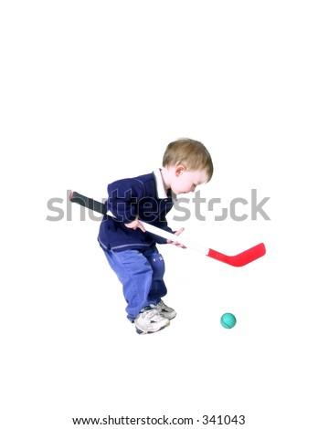 toddler playing hockey - stock photo