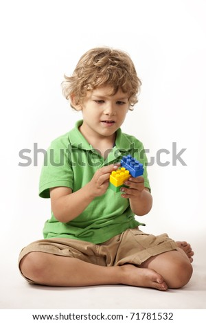 Toddler playing with building blocks