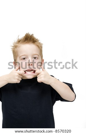toddler pulling a silly face - stock photo