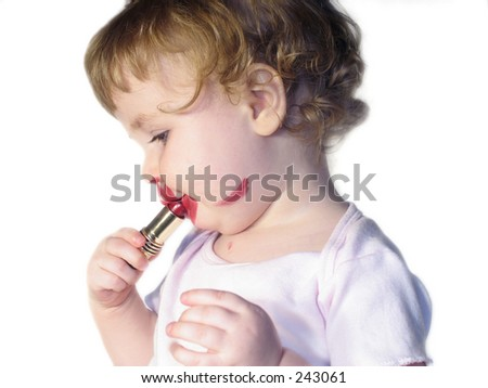 toddler putting on red lipstick on white background - stock photo