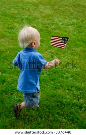 Toddler running around waving an American flag - stock photo