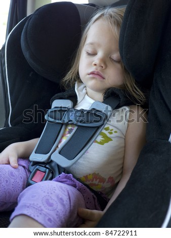 Toddler Sleeping in a Car Seat - stock photo