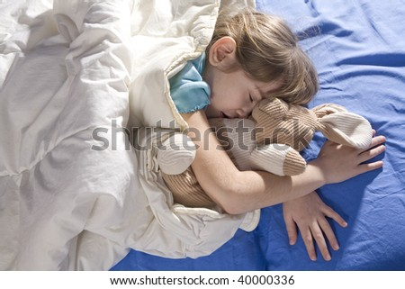 Toddler sleeping with her hare - stock photo