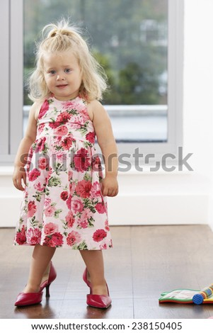 Toddler Standing in High Heels