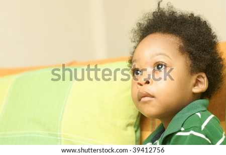 toddler staring into space - stock photo